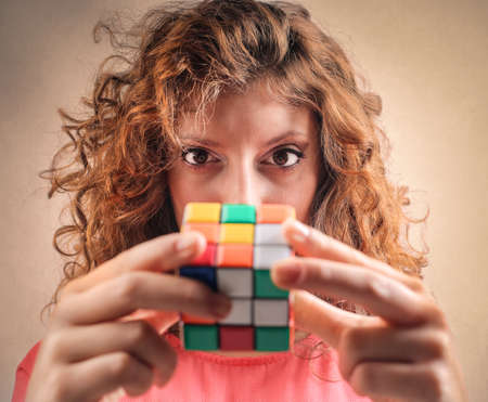 solving: Trying to solve the Rubik cube Stock Photo