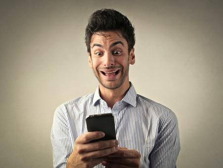 jubilate: Man using a smartphone Stock Photo