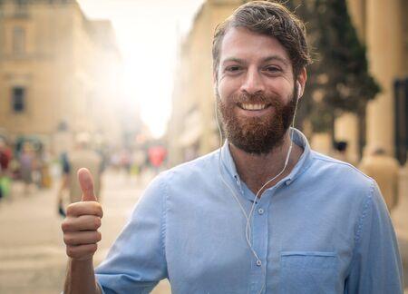 feeling happy: Happy bearded man feeling positive