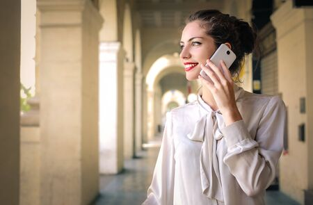 answering: Happy woman answering a call