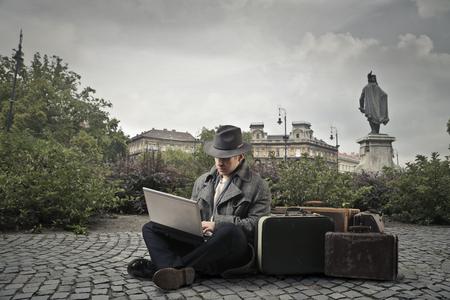 sitting on the ground: Traveler sitting on the ground Stock Photo