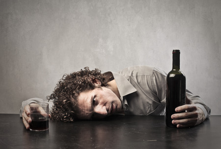 alcoholic man: Drunk man drinking a whole bottle of wine