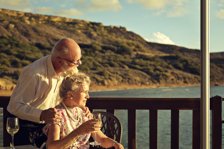 Elderly couple at the seaside Stock Photo