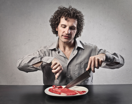 flesh: Man eating raw meat