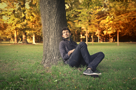 people relaxing: Man sitting at the park Stock Photo