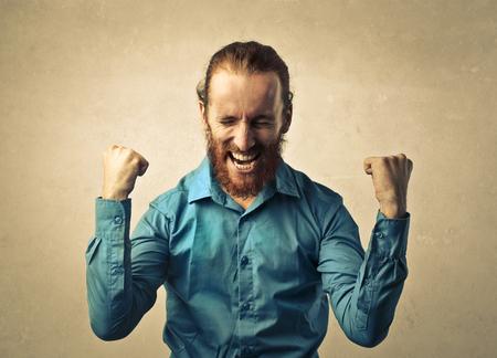 jubilating: Red-haired man jubilating