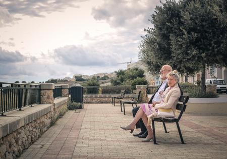 couples outdoors: Couple sitting on a bench