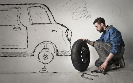 pneumatic tyres: Changing a wheel Stock Photo
