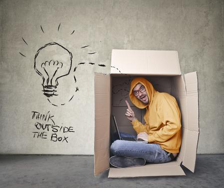 Denk buiten de doos Stockfoto
