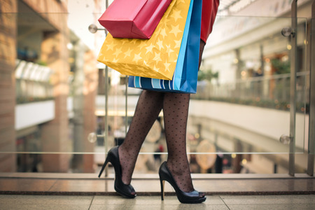 closeup on legs: High heels and shopping bags