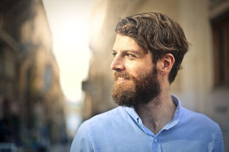 handsome: Smiling bearded man Stock Photo