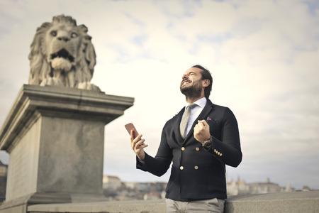 jubilate: Successful businessman in elegant clothes Stock Photo