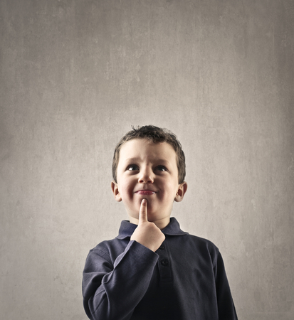 to ponder: Young child thinking Stock Photo