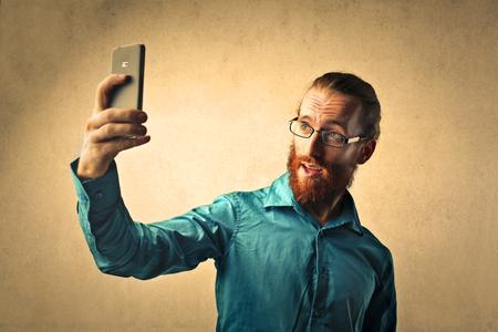 narcissism: Bearded man doing a selfie