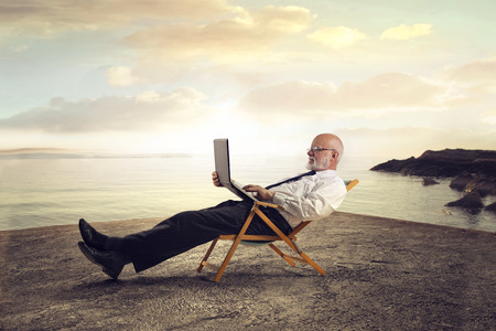 write: Relaxed businessman at the beach