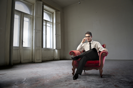 Man sitting in an empty room photo