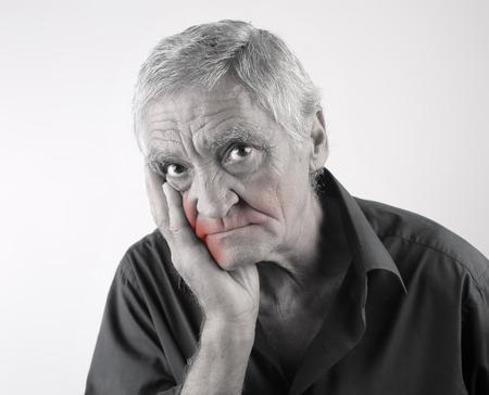 L'uomo che soffre di mal di denti Archivio Fotografico