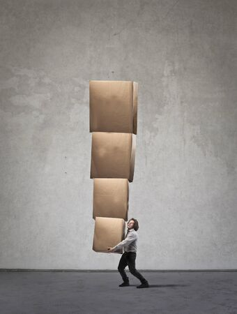 carrying heavy: Carrying heavy boxes Stock Photo