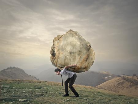 trabajando duro: Un peso fuerte como para soportar Foto de archivo