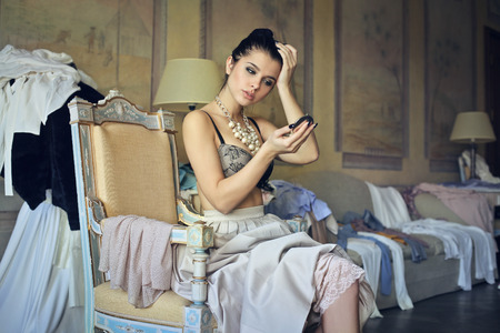undress: Classy young woman getting ready Stock Photo