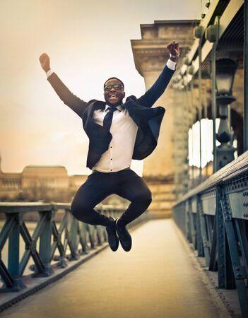 businessman jumping: Happy businessman jumping