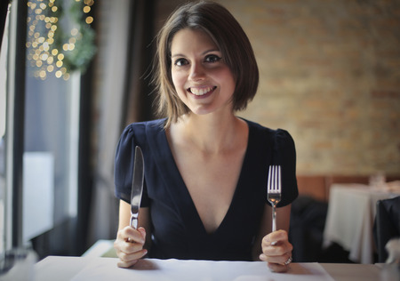 woman eat: Happy woman at the restaurant