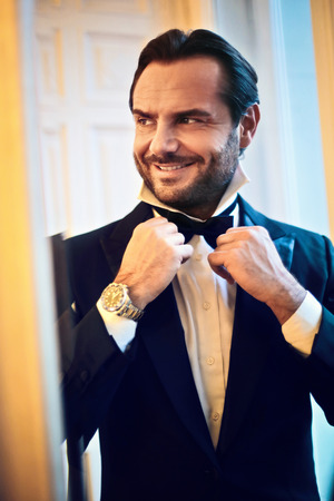 getting dressed: Elegant man getting dressed Stock Photo