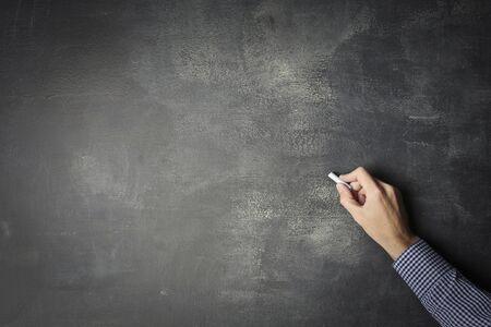 plaster board: Man writing on a blackboard Stock Photo