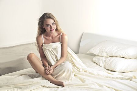 blonde woman: Blonde woman sitting in bed