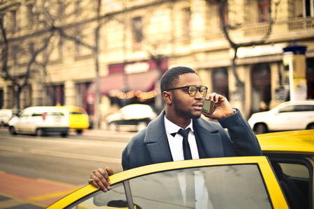 catching taxi: Businessman catching a taxi