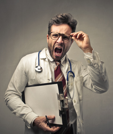 wrath: Angry doctor screaming Stock Photo