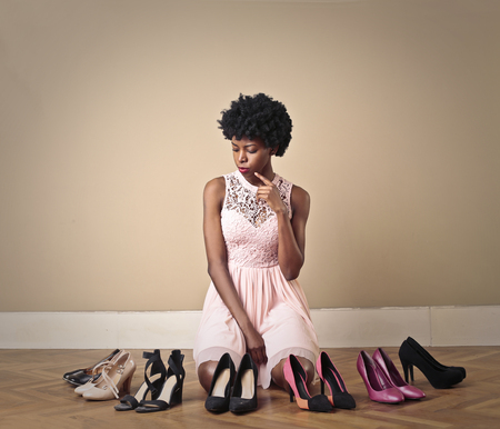 high  heeled: Girl choosing high heeled shoes
