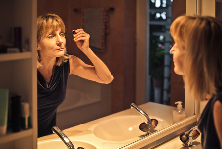 Woman getting ready to go out Stock Photo