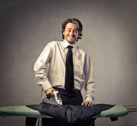 ironic: Man doing the ironing