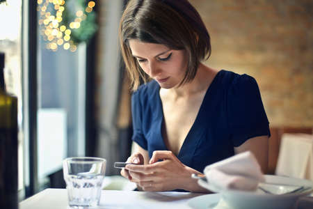 hear business call: Woman at the restaurant