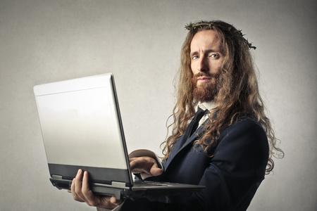 ironic: Jesus holding a pc Stock Photo