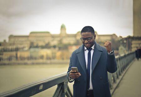 exult: Businessman walking on the bridge Stock Photo