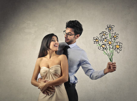 phantasy: Man holding flowers for his woman Stock Photo