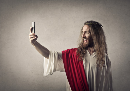 Jesus doing a selfie 스톡 콘텐츠
