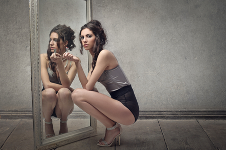 Womans reflection in a mirror Stock Photo