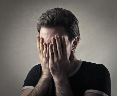 desperation: Desperate man covering his face