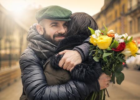fall winter: Man hugging his girlfriend
