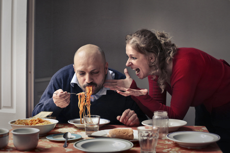litigate: Man and woman arguing at lunch