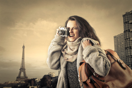 europe travel: Woman taking pictures in paris Stock Photo