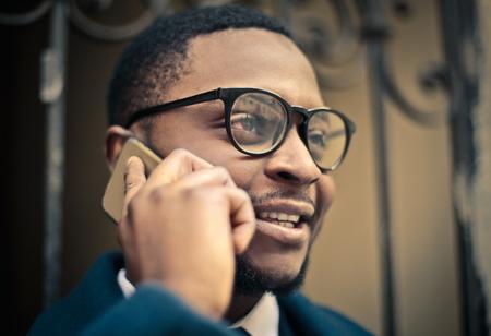 hear business call: Man doing a phone call Stock Photo