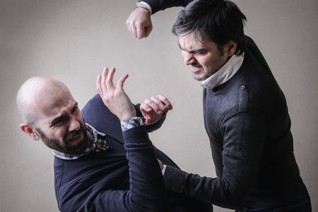 beat: Men in a fight Stock Photo