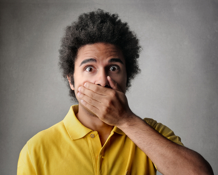 accusations: Shocked boy holding his breath Stock Photo