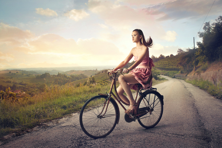 vintage landscape: Beauty riding a bike