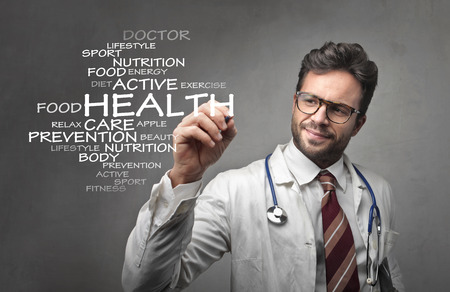 medico: Doctor writing the word health Stock Photo