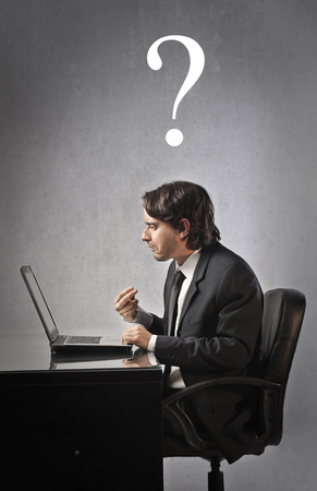 point of demand: Confused employee in front of his laptop Stock Photo